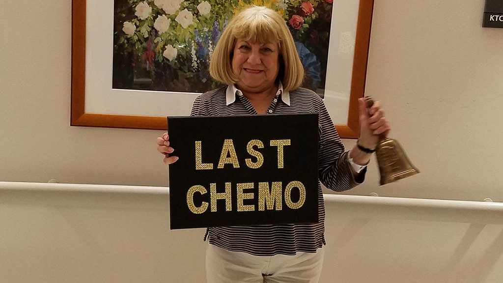 "Multiple myeloma survivor Marie Chaplinksy holds up ""last chemo"" sign"