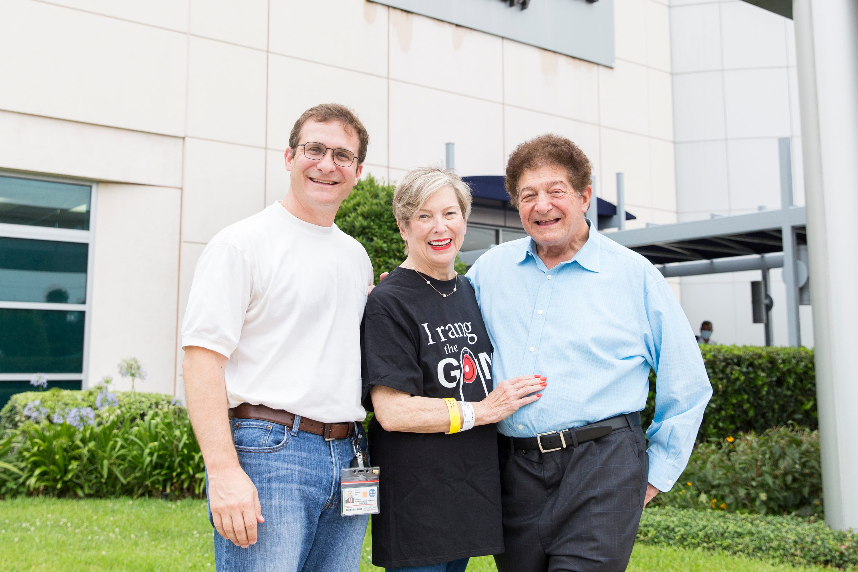 Cookie Frank stands outside MD Anderson Proton Therapy Center with her son, Steven Frank , M.D.,  and her husband, Milton Frank III, M.D.