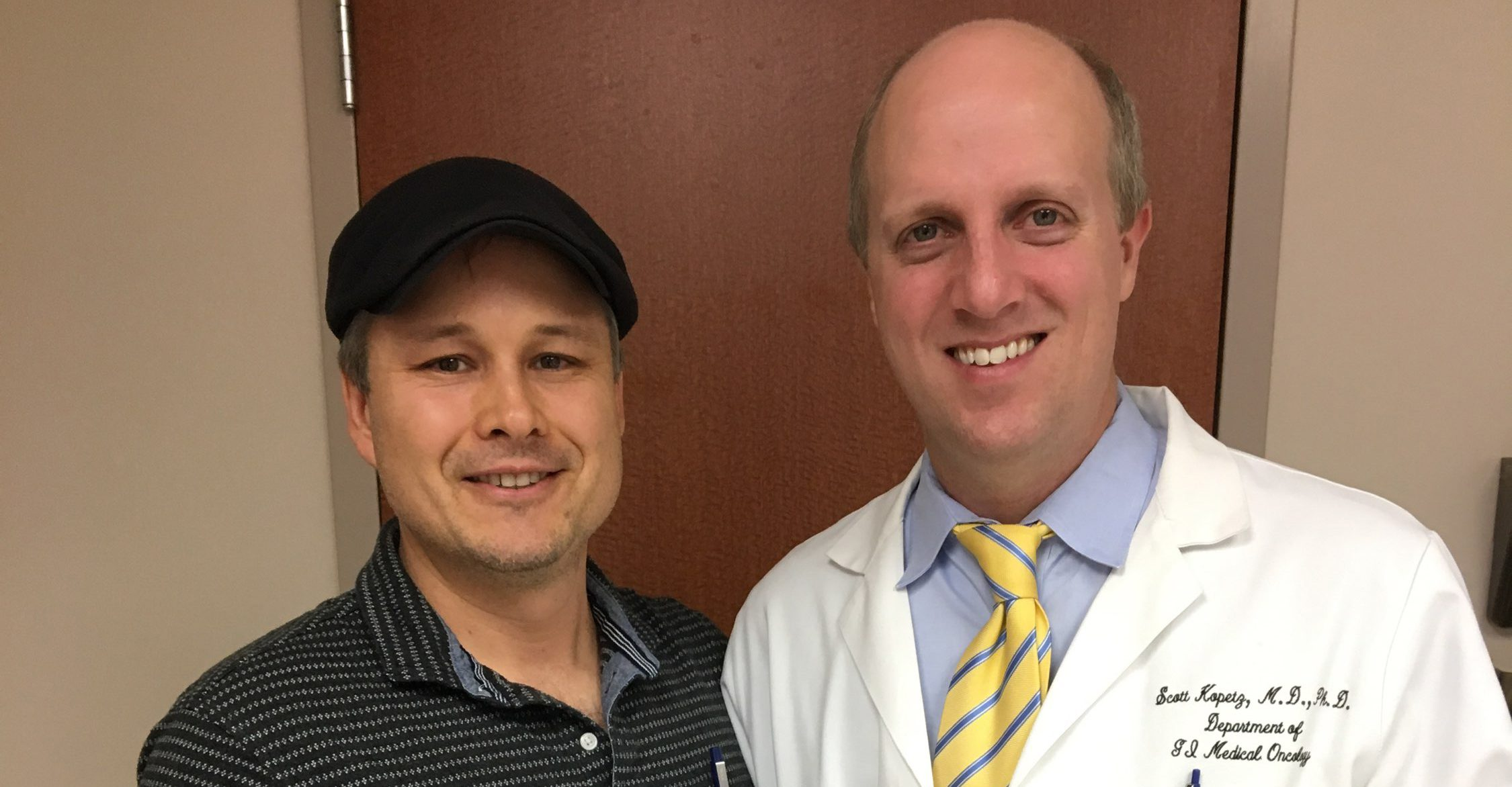 Colorectal cancer survvior Dr. Anatole Karpovs (left) with Dr. Scott Kopetz