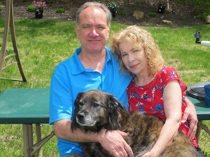 Charles and Debbie Salazar with their dog
