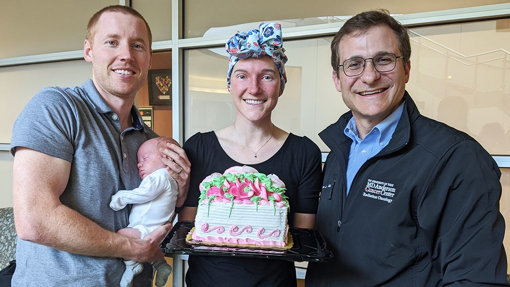 Sinonasal undifferentiated carcinoma survivor Alyssa Warr (middle) with her family and Steven Frank, M.D. (right)