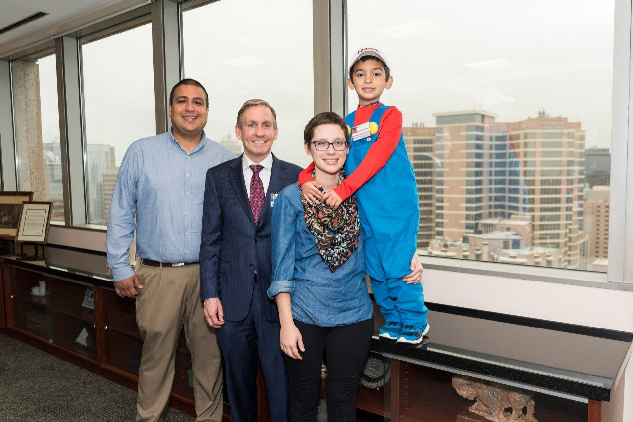 Peter Pisters meets with cancer survivor and her philanthropic 7-year-old son.