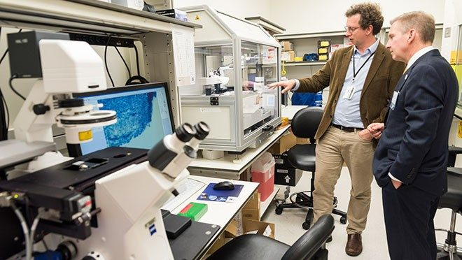 Peter Pisters tours a genetics laboratory