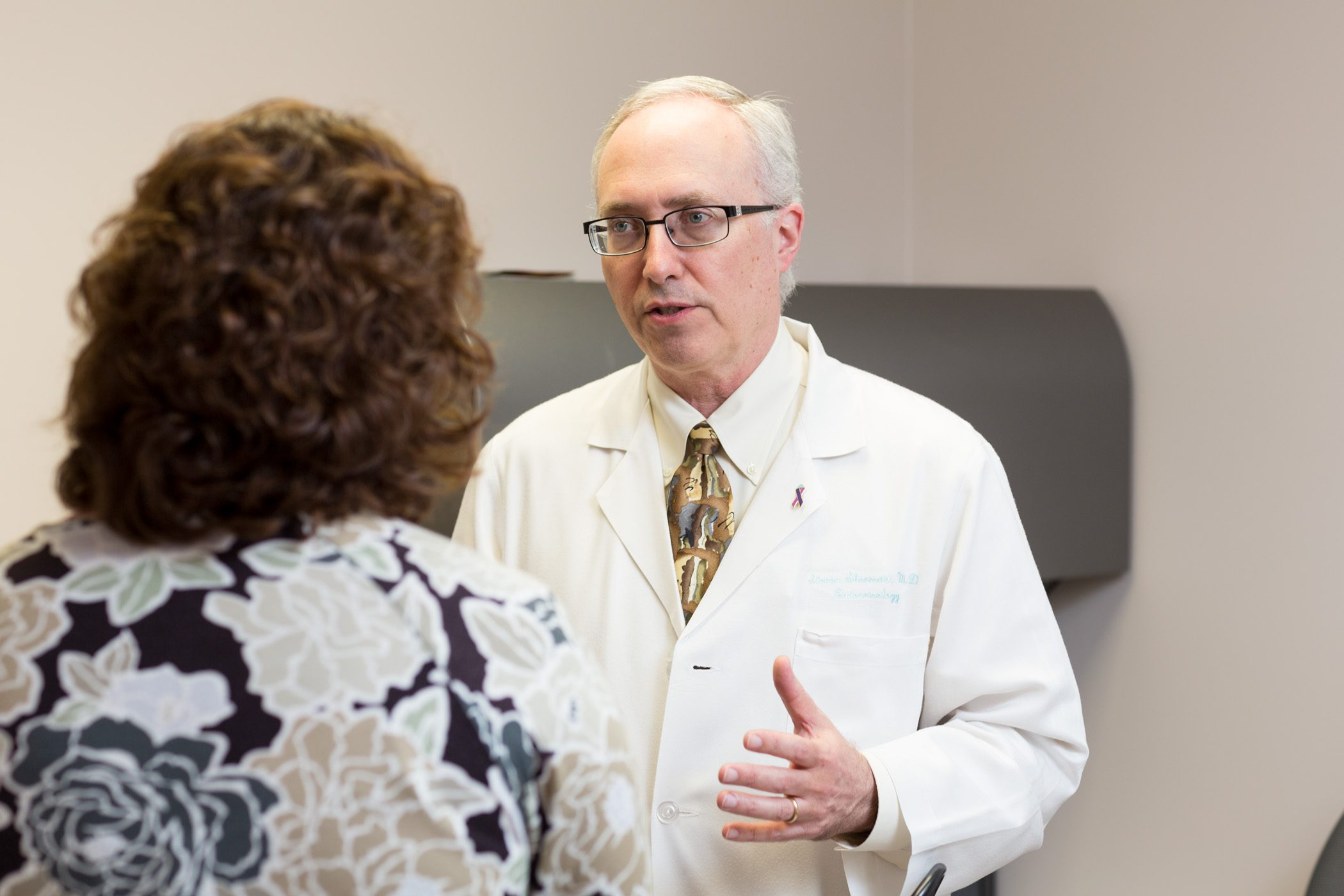 Dr. Sherman meets with patient