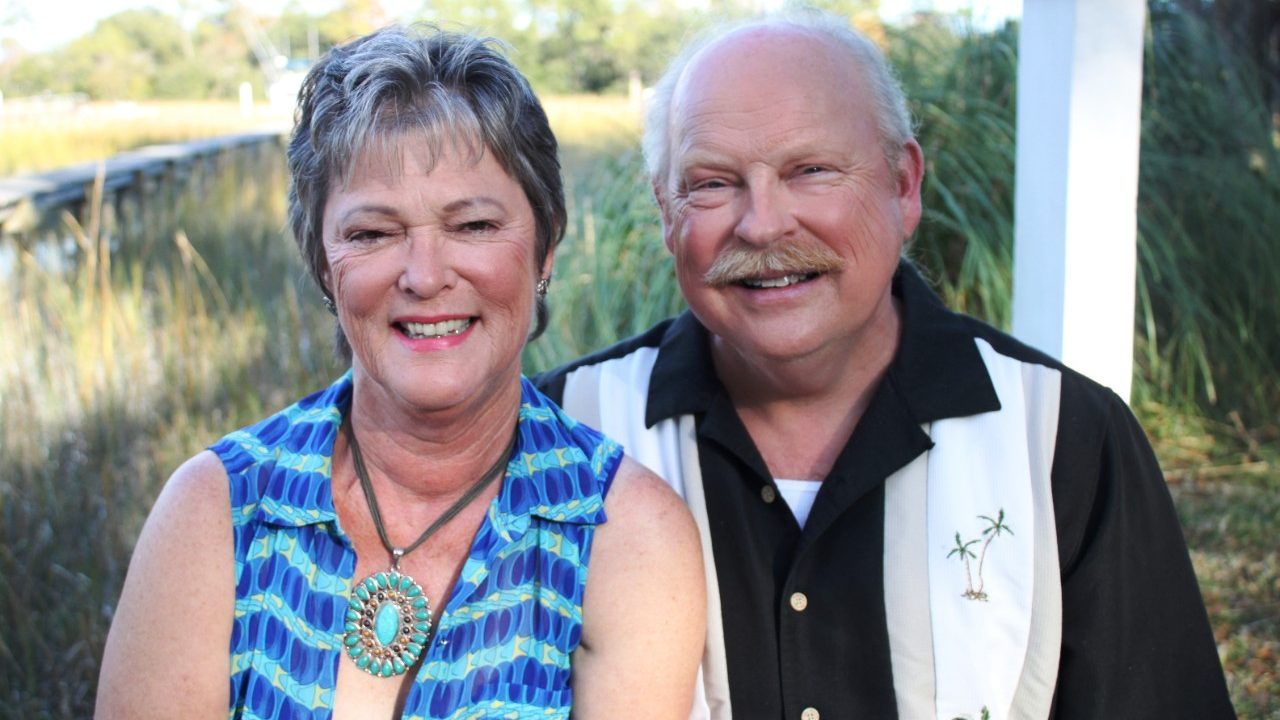 Triple-negative breast cancer survivor Robbie Johnson and her husband are all smiles, thanks to a clinical trial