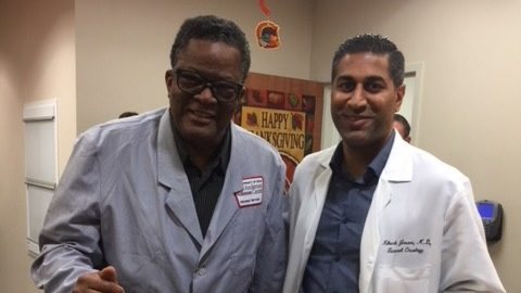 Caregiver to breast cancer survivor and volunteer Walter Ross (left) poses with Nikesh Jasani, M.D.