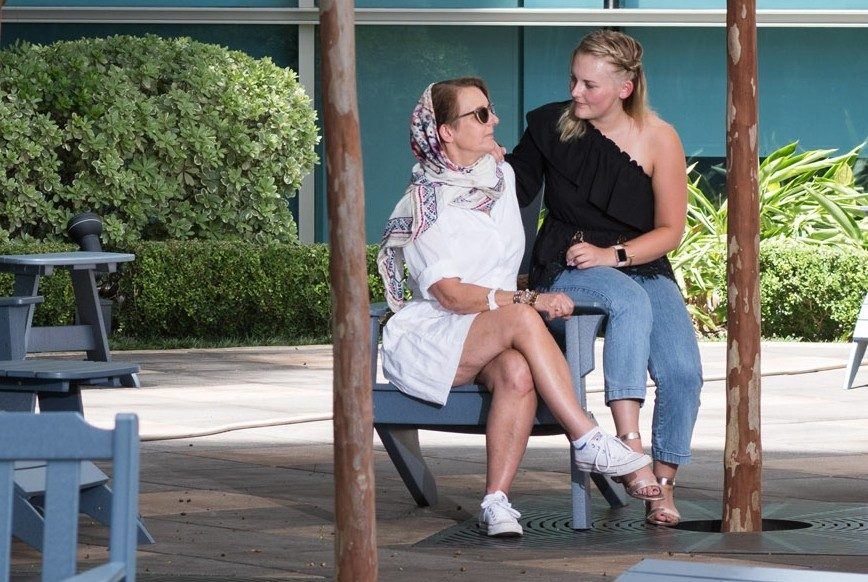 Granular cell cancer survivor Linda Thomas and her daughter, Carrick Terhune, on the patio at MD Anderson's Mays Clinic