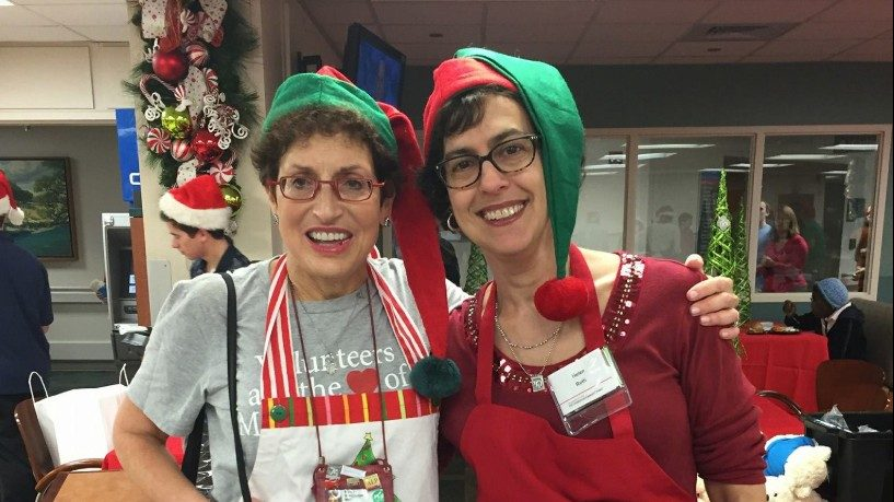 Helen Kalmans (right) with Mindy Wertheimer, director of Volunteer Services and Merchandising