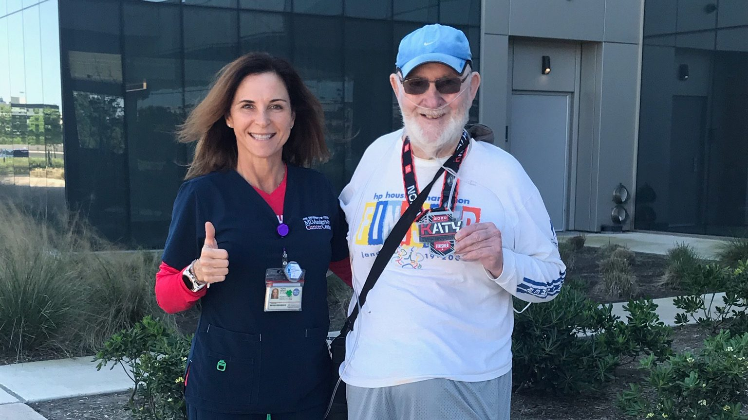 Radiation therapist Karrie Bellard and pancreatic cancer survivor Ken Rogers outside of MD Anderson West Houston