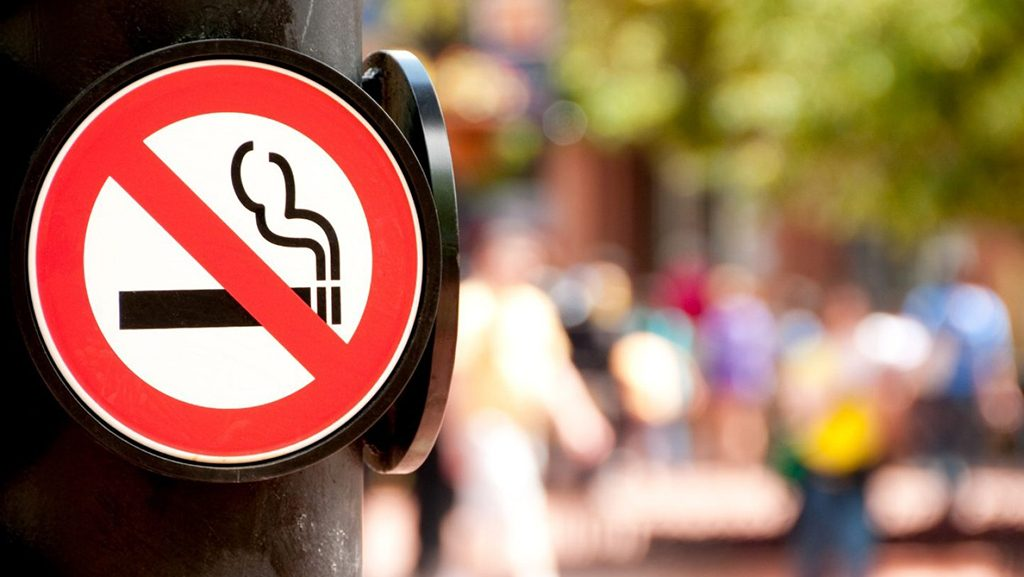 No smoking sign on a post in a public space