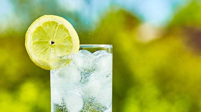 glass of sparkling water with a lemon wedge