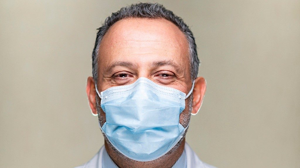 Chief Infection Control Officer Roy Chemaly, M.D., wears a medical-grade face mask in close-up portrait