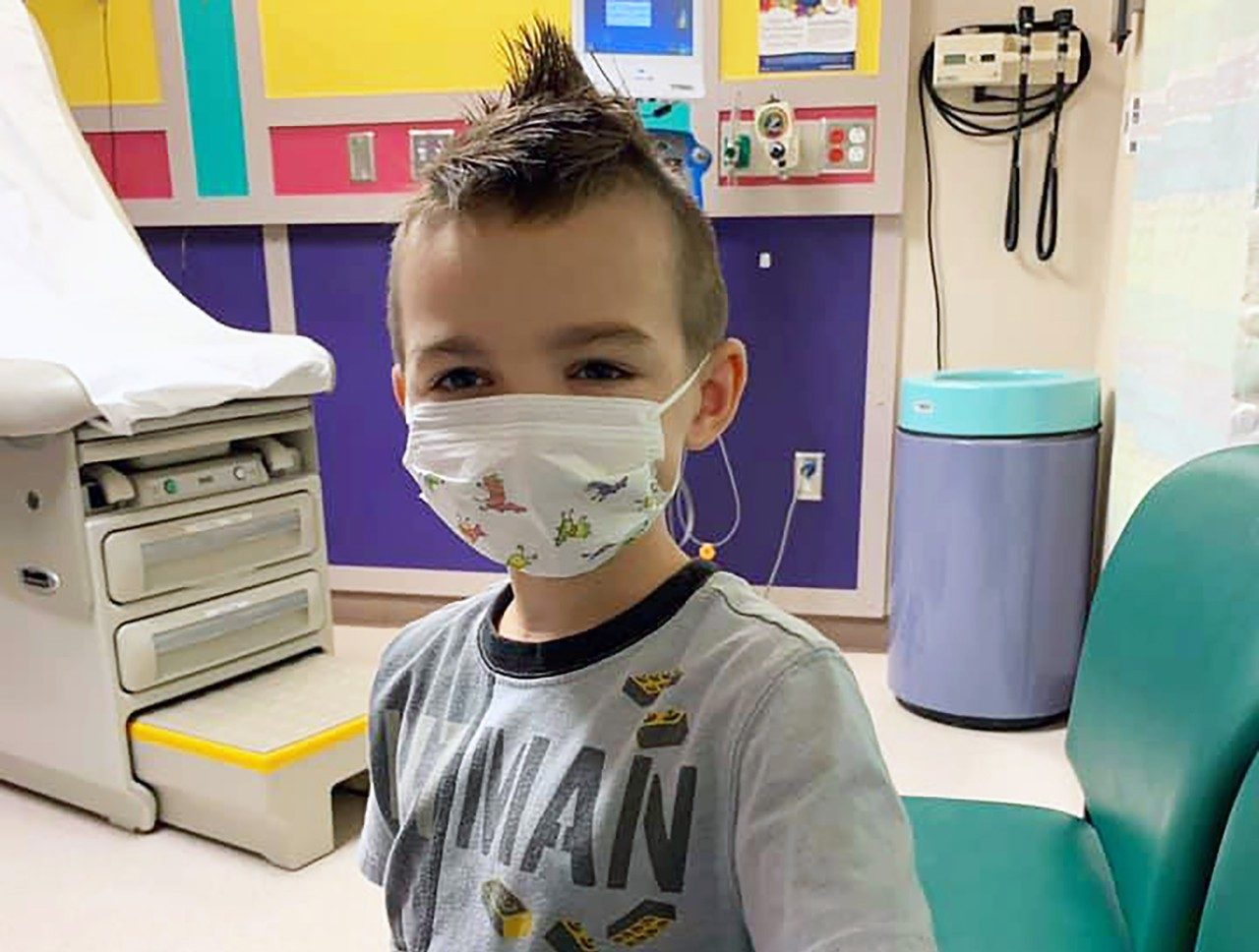 Embryonal rhabdomyosarcoma survivor Sawyer Hack, pictured in a face mask