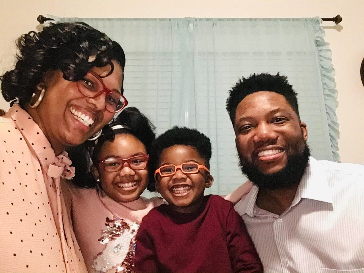 Colorectal cancer survivor Al Thomas with his wife, Demetria, and their kids