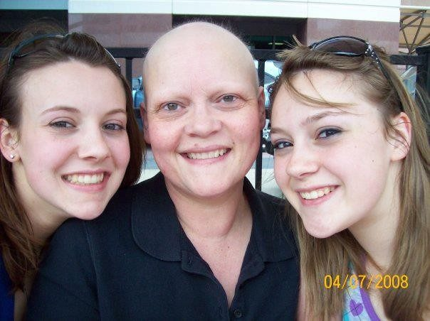 Pam Scarpino, ovarian cancer survivor and clinical trials participant, with her daughters