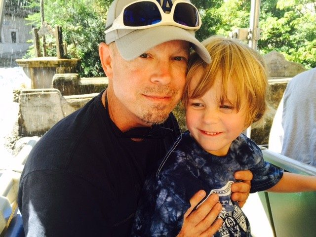 Throat cancer survivor and clinical trials participant Scot St. Martin with his youngest son, Sean