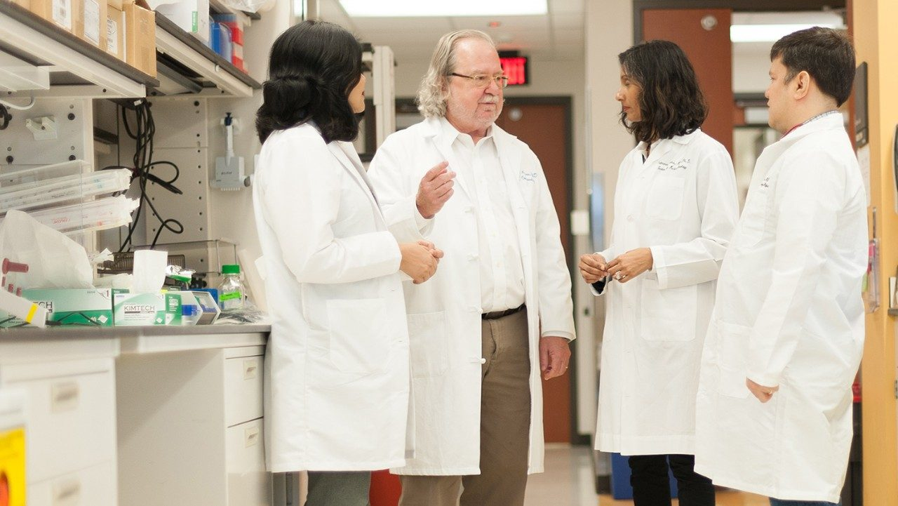 Jim Allison, Padmanee Sharma and two others in a lab