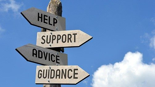 Signs that read help, support, advice and guidance