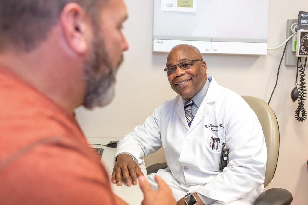 Curtis Pettaway, M.D., consulting with patient