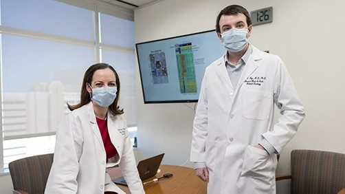 Researchers wearing face masks