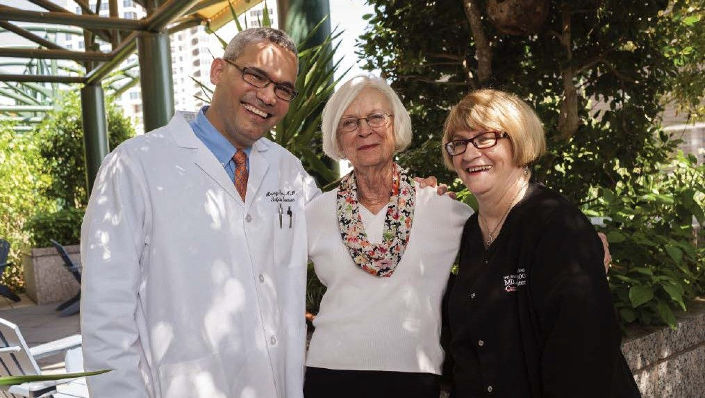 MD Anderson Hepatitis patient Jan Barbo, with Harrys Torres, M.D., and clinical nurse Ruth Roach