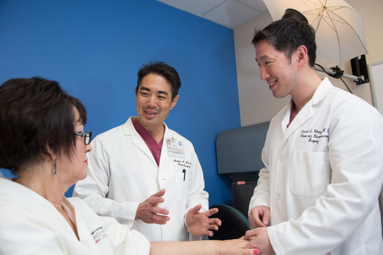 Edward Chang, M.D., and Matthew Hanasono, M.D., speak with a patient