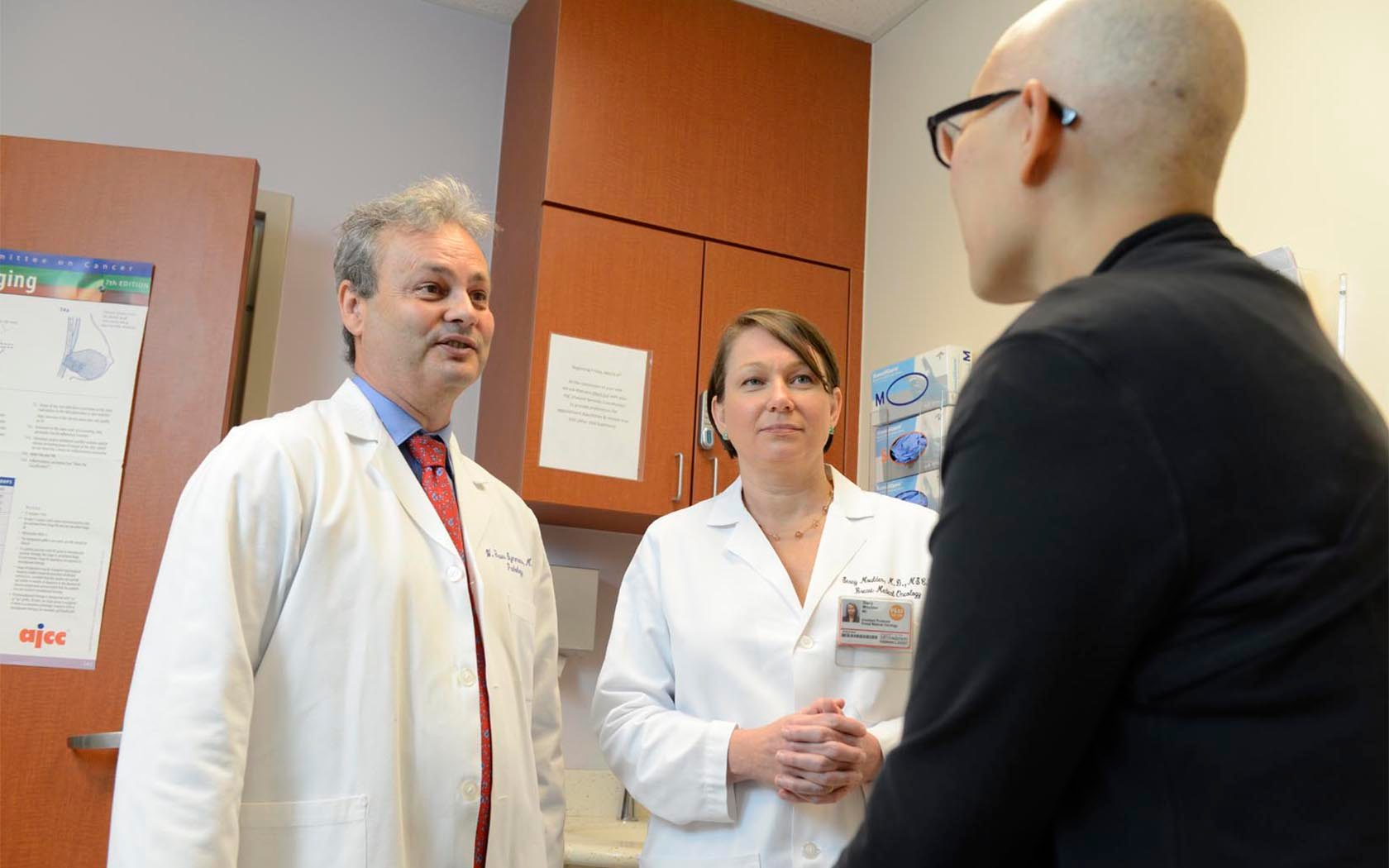 W. Fraser Symmans, M.D., and Stacy Moulder, M.D. with patient Janine Blackwell