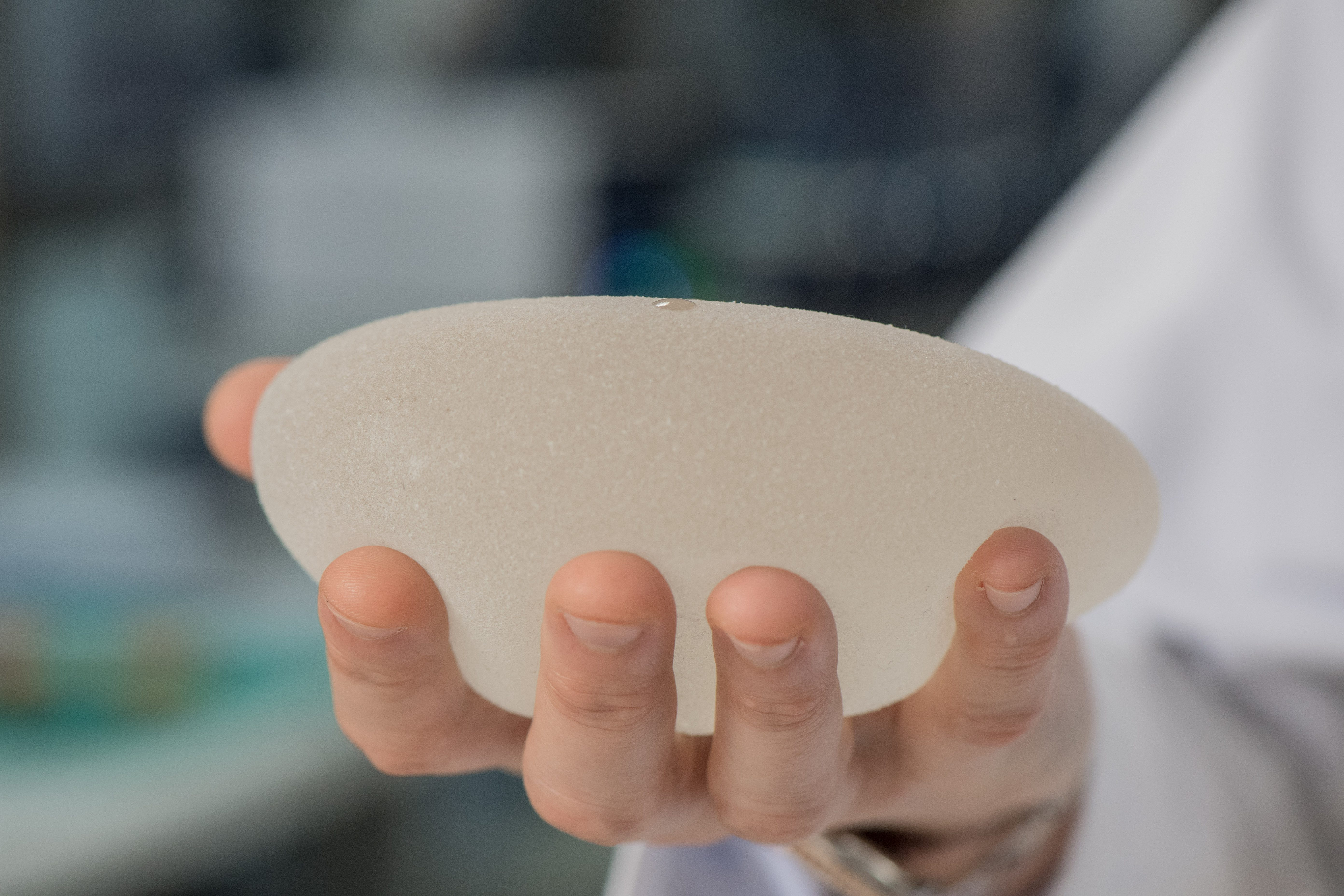 Mark Clemens, M.D., holds a silicone breast implant.