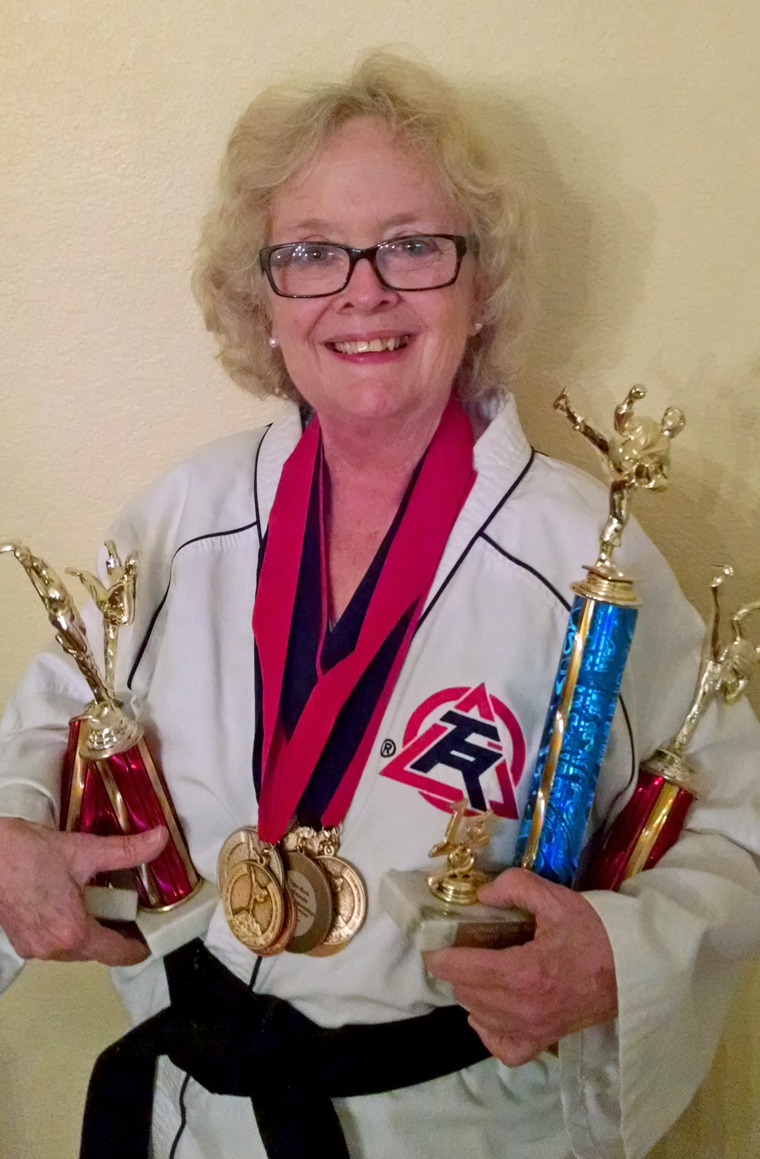Taekwondo champion Paula Johnson is back in action after beating acoustic neuroma.