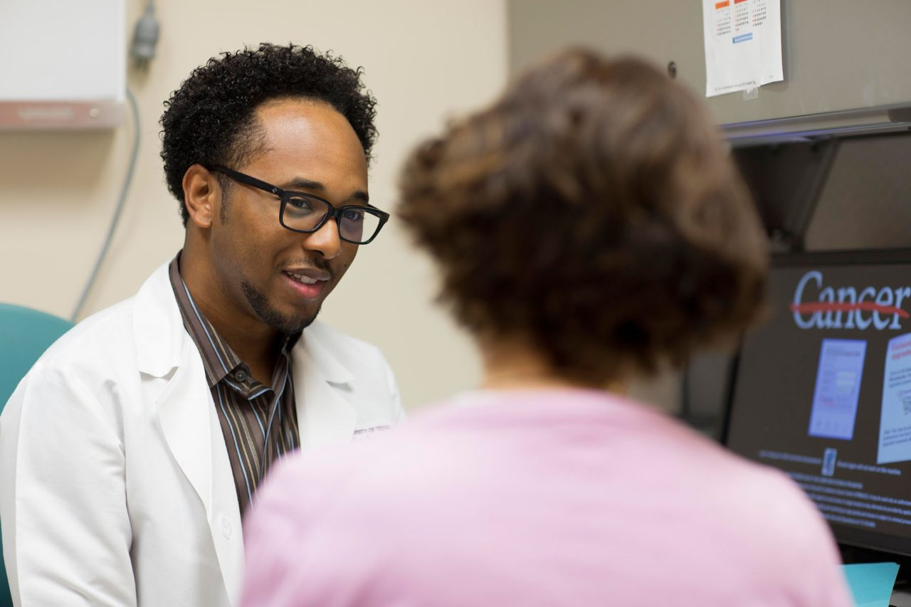 Cancerwise blog photo: Senior research nurse Franklin Wynn speaks with a patient.