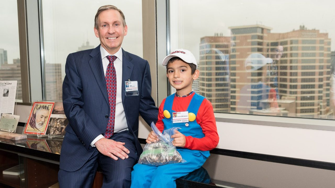 Cancerwise blog post: Brayden Rivera sits with Dr. Peter Pisters after raising money to help end cancer for patients like his mom, who has breast cancer