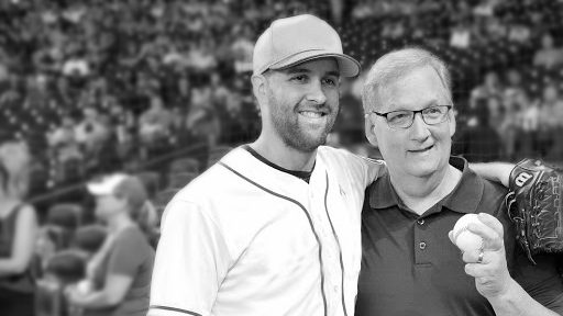 Collin McHugh wraps his arm around his dad -- a prostate cancer survivor -- during a baseball game