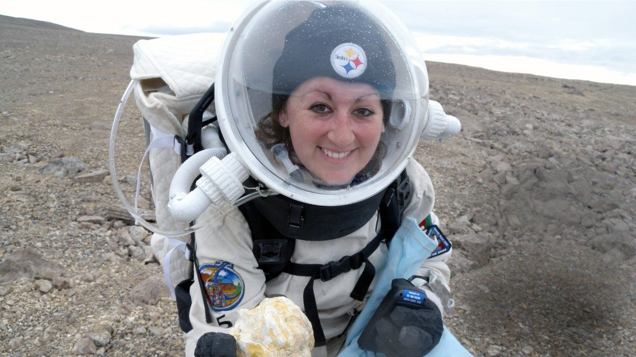 Graduate student Kristine Ferrone in her space exploration gear while researching radiation shielding and its benefits for cancer treatment