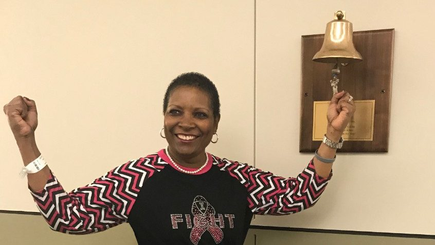 Breast cancer survivor Cheryl Ratliff rings the bell to mark the end of her treatment