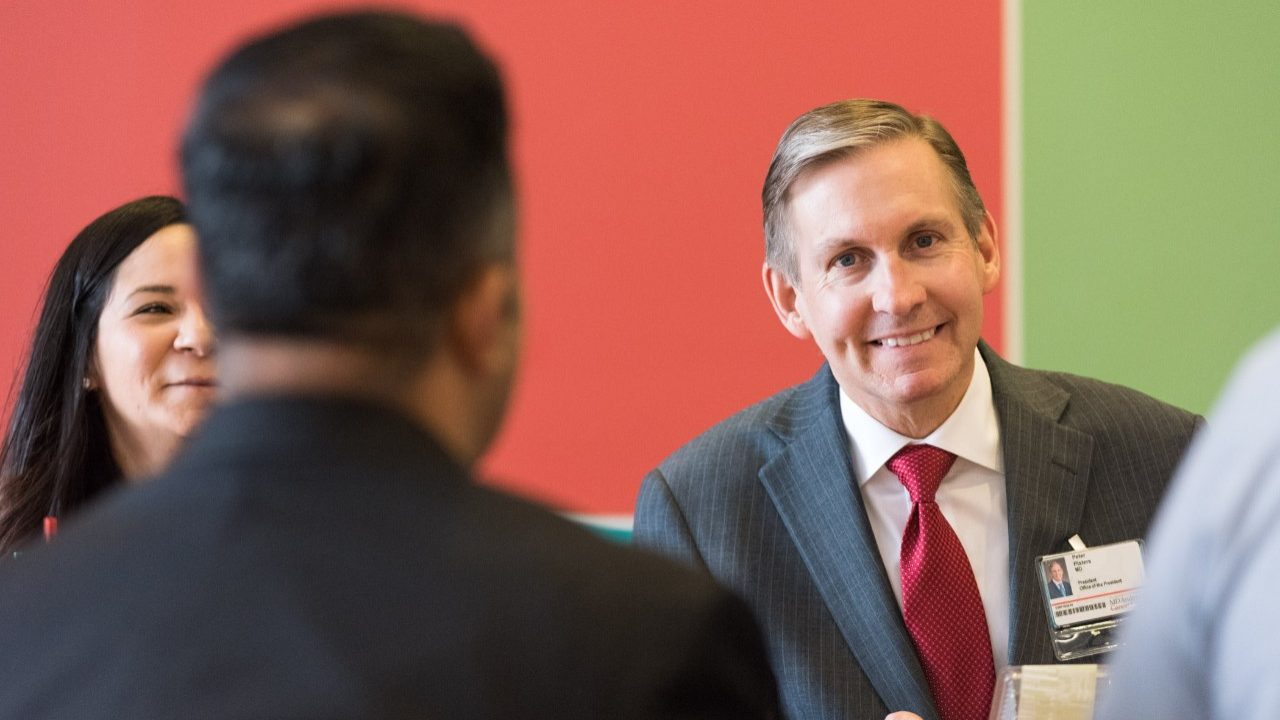 MD Anderson president Peter WT Pisters, M.D., smiles during a meeting with staff