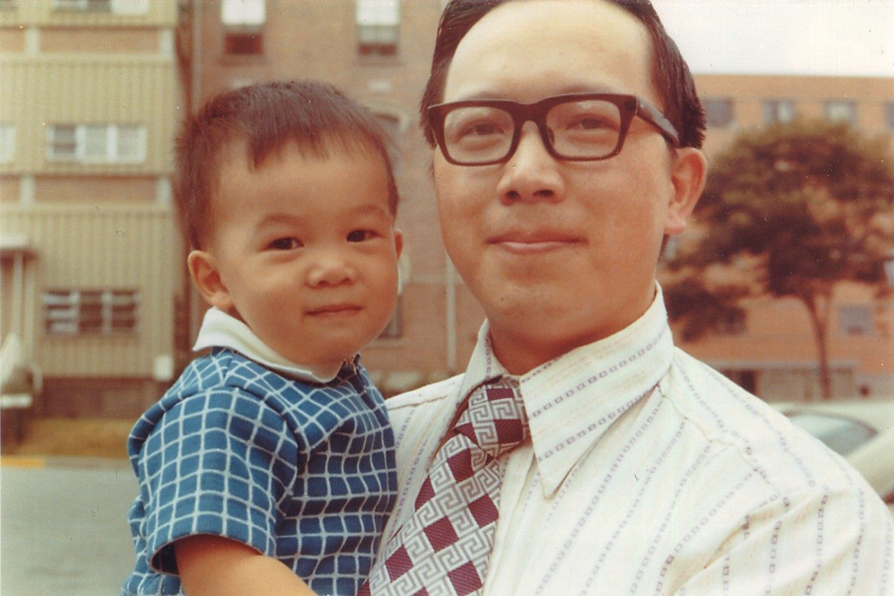 A young Stephen Lai, M.D., Ph.D., poses with his father.