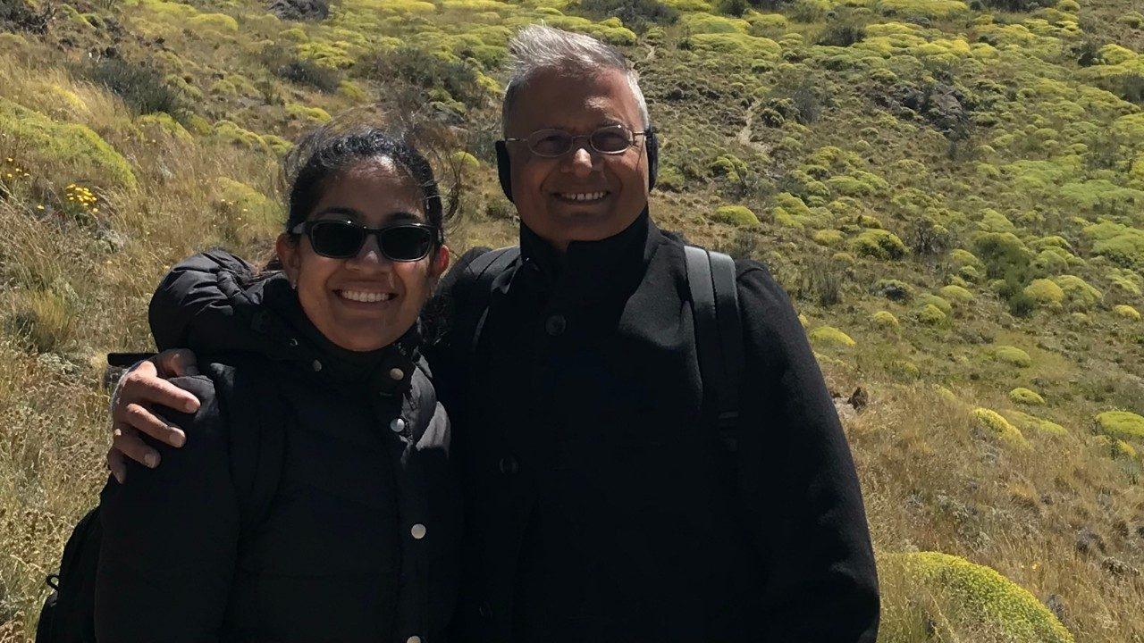 Ekta Gupta, M.D., poses with her father.
