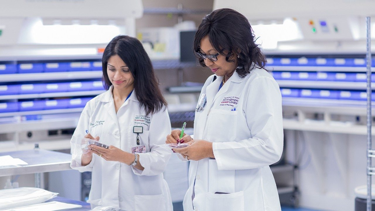 Inpatient pharmacists Mariamma (Leni) Varghese, Pharm.D., left, and Ifeoma Okafor, Pharm.D, review medications.