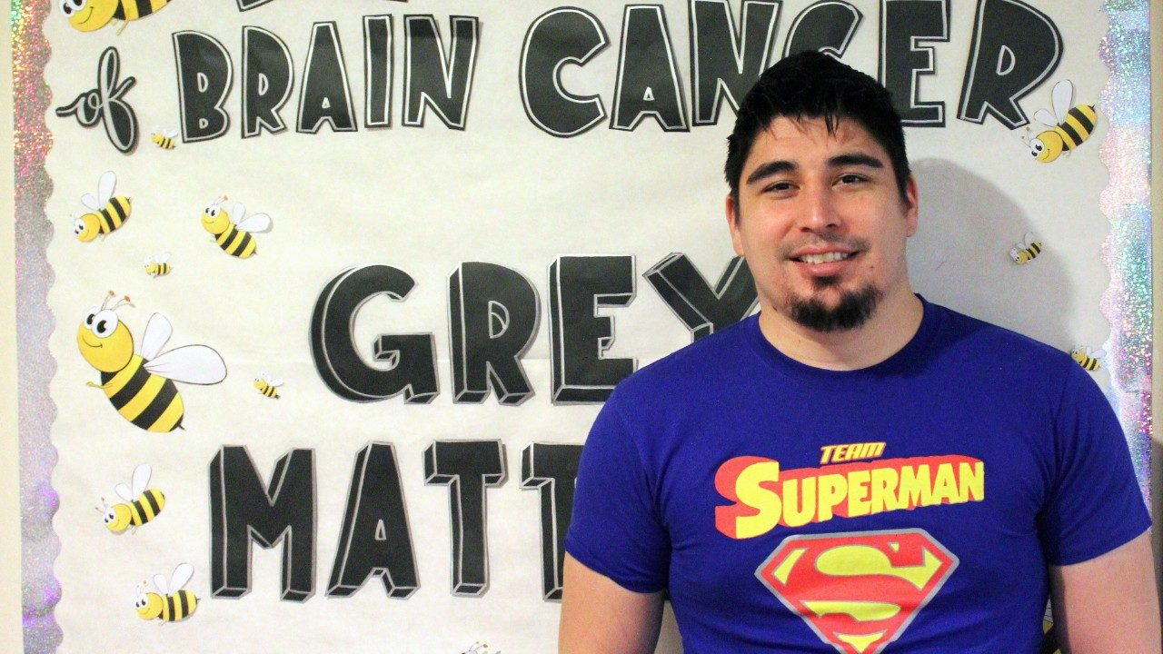 Pleomorphic xanthoastrocytoma brain tumor survivor Roberto Saenz poses in a 'Team Superman' shirt.