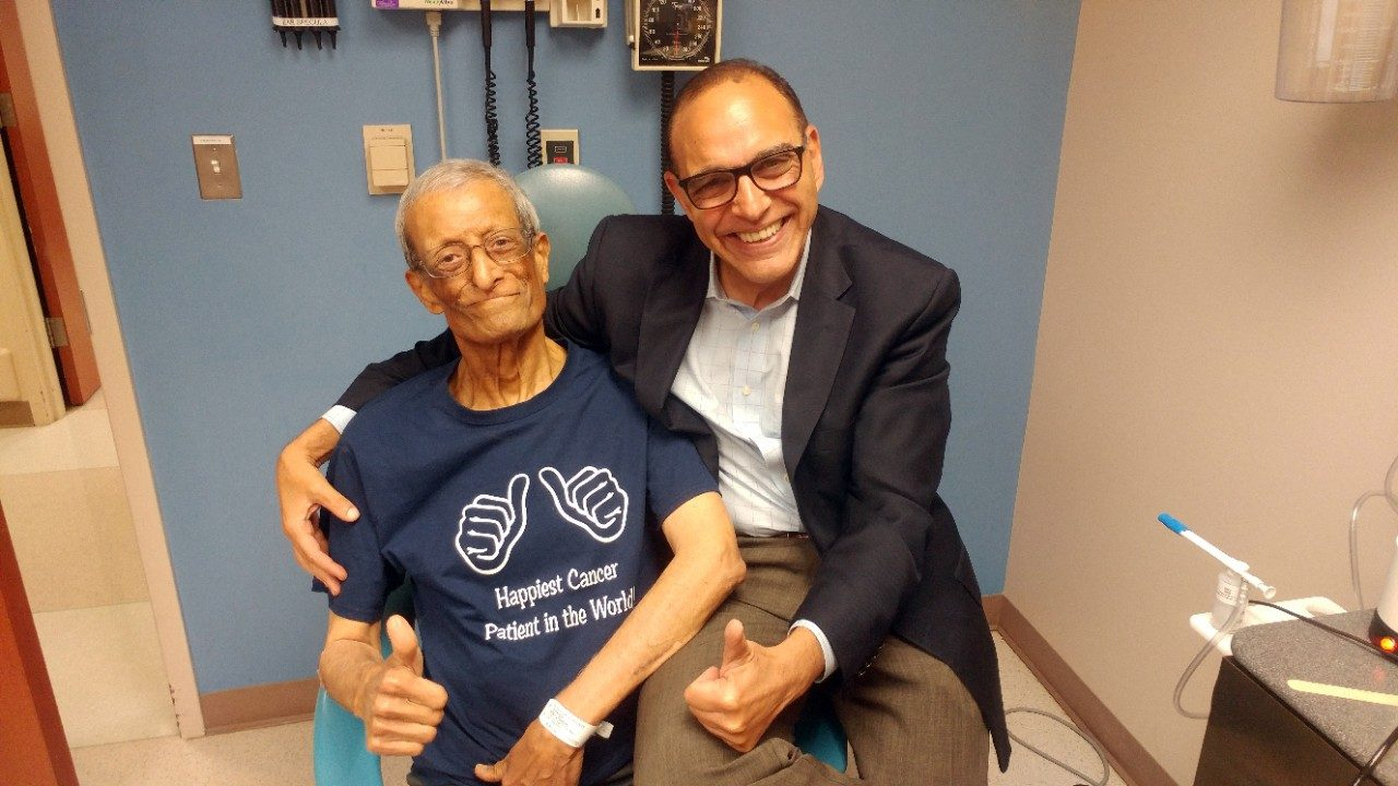 Oral cancer survivor Adel Tawfik poses with Ehab Hanna, M.D., after successful treatment.