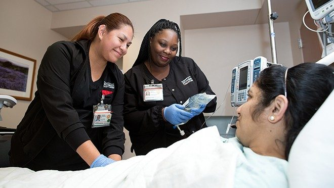 Jaquelin Velasquez, left, and Misha Hawkins perform the two-nurse verification process prior to infusing a patient with CAR T cells.