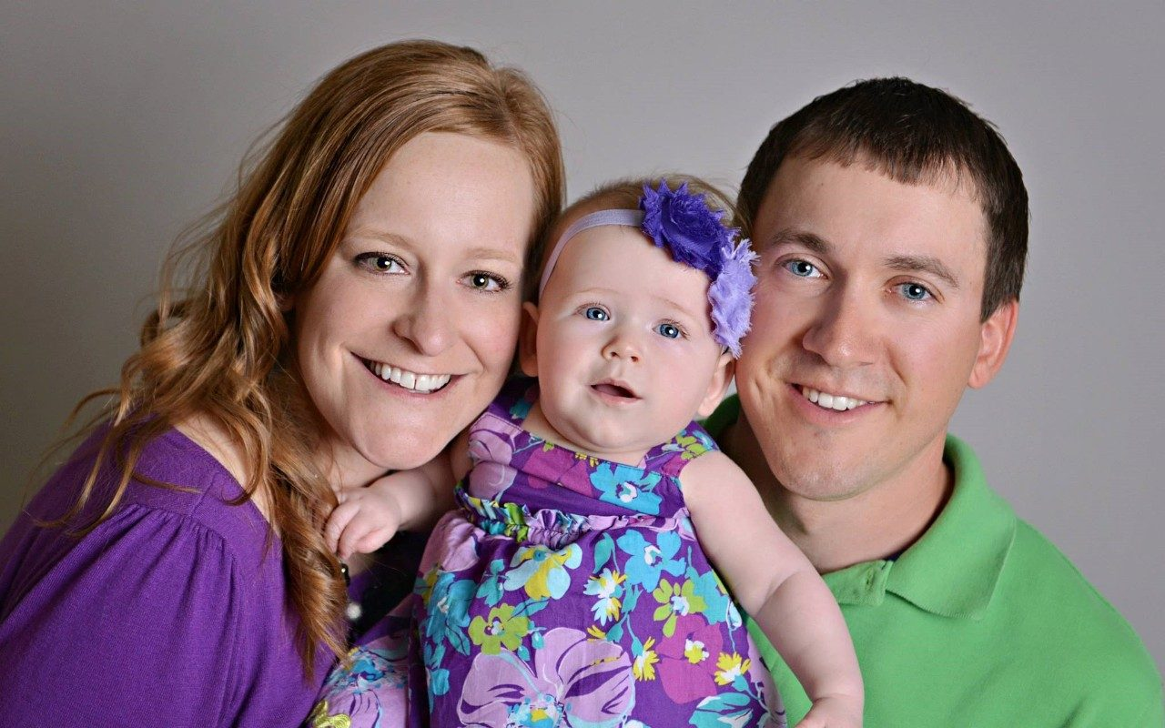 Melanoma survivor Ashley Seykora with her family