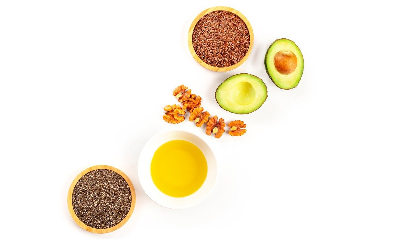 Photo of avocado, flax seeds and other omega-3 sources