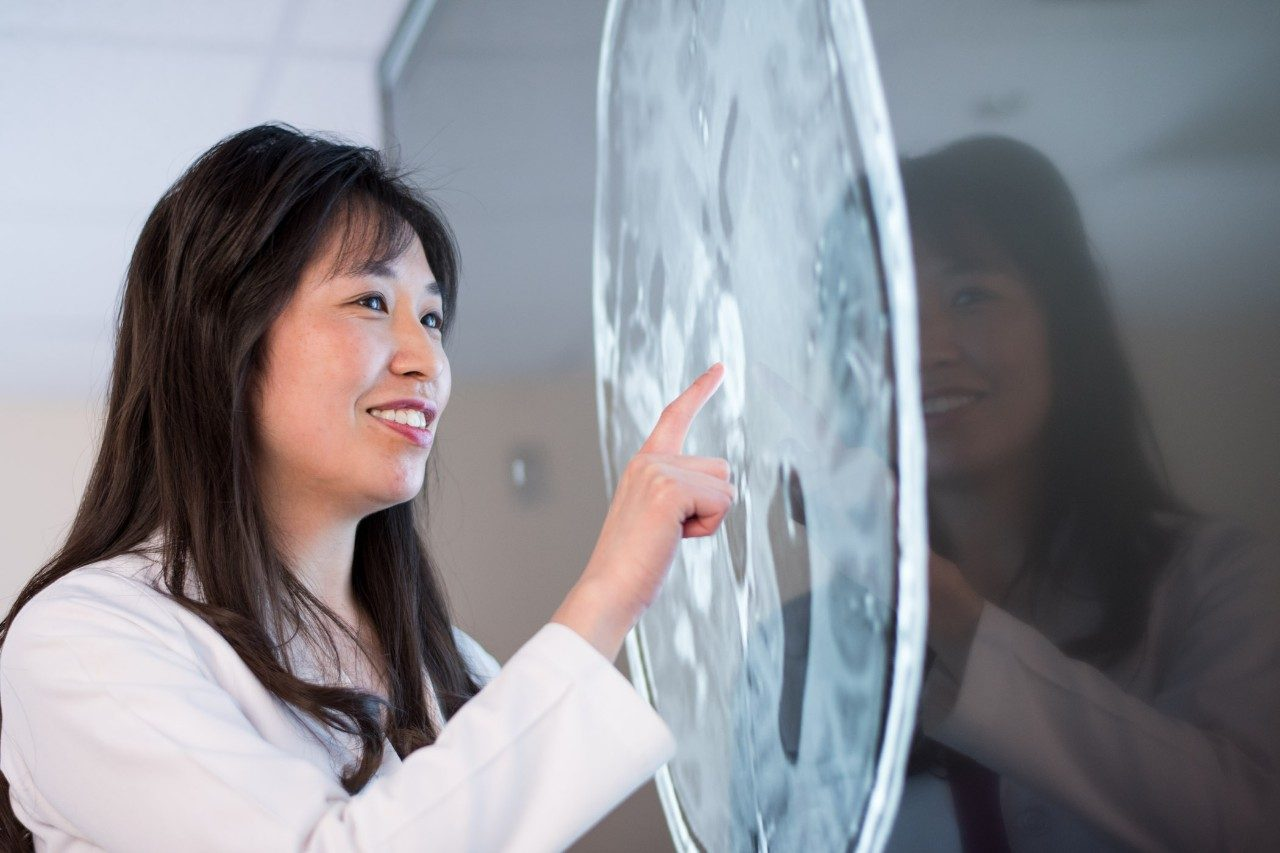 Glioblastoma expert Dr. Shiao-Pei Weathers looks at a brain scan