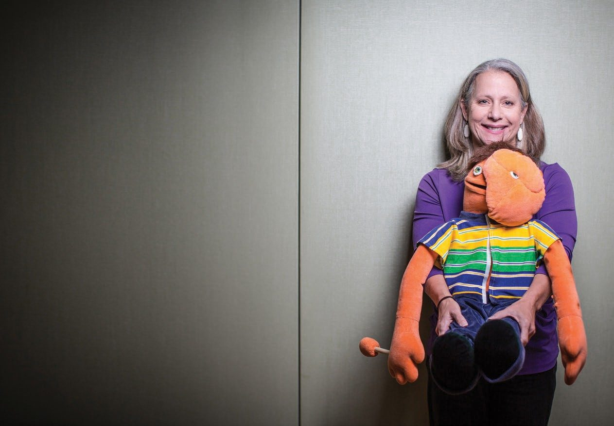 Pediatric education coordinator Mari Frost with Reggie, a puppet that depicts neurofibromatosis.