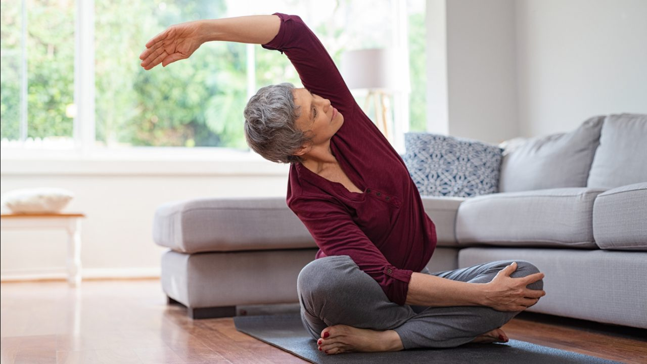 Woman stretches in her living room