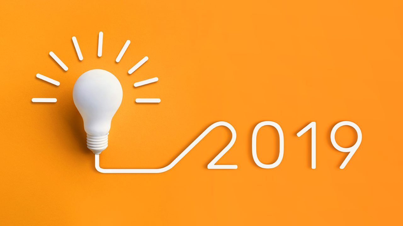 Orange background with light bulb and text: 2019