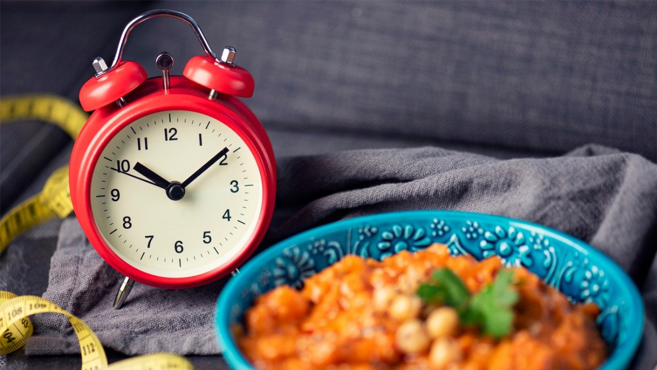 clock with a bowl of stew
