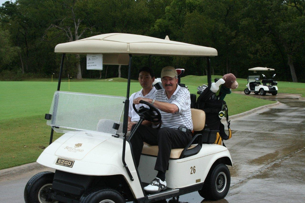 MD Anderson's Kevin Kim, M.D., left, and Michael L. Maris, M.D., a Dallas-based dermatologist who provided free cancer screenings at the 2008 Mulligans for Melanoma, enjoy a round of golf in support of the Bradley O'Martin Melanoma Foundation. Photo courtesy of Yvonne and Alan O'Martin.