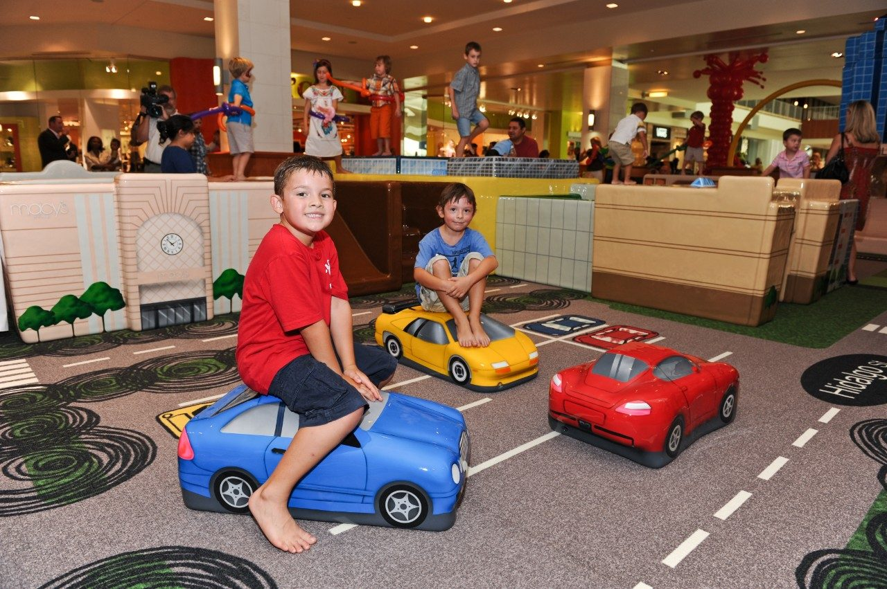 Children navigate the traffic at a June ribbon-cutting ceremony at the Little Galleria. Photo by Victor Scott.
